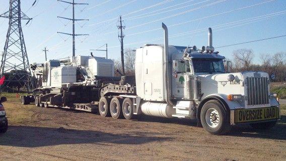 8 axle rgn hauling crane