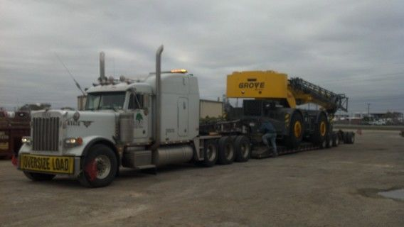 8 axle rgn hauling heavy equipment