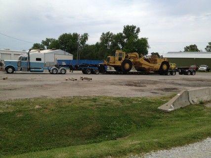 9 Axle Hauling Heavy Equipment